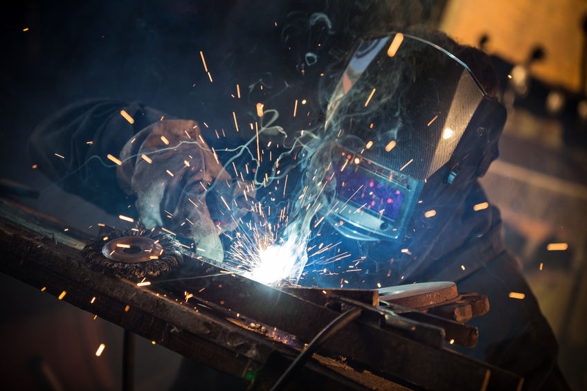 46281294 - working welder in action with bright sparks.